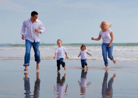 Family on a beach heaving fun.